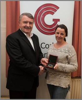 CCG Chairman Noel O'Connell pictured with Niamh Whitty and her Brendan Walkin Medal