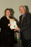 IPF president John Cuddihy presents Helen Devitt with Licentiateship of the IPF.