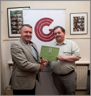CCG Noel O\'Connell presenting Bill Power with his EFIAP distinction