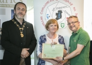 IPF President Michael O\'Sullivan and IPF FIAP Liaison Officer Paul Stanley pictured presenting EFIAP distinction to Ann Francis