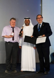 Morgan O'Neill pictured with Abdullah Al Amri (Director of Arts and Culture Department at ADACH) and Riccardo Busi (President of FIAP)